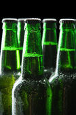 Bottles of beer on black background — Stock Photo