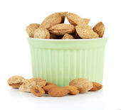 Almond in bowl, isolated on white — Stock Photo