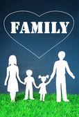 Familie aus papier auf gras auf hellem hintergrund — Stockfoto