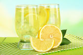 Delicious lemonade on table on light blue background — Stock Photo