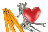 Heart and tools. Concept: Renovation of heart. — Stock Photo