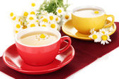 Cups of herbal tea with camomiles close up — Stock Photo