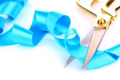 Satin ribbon curled around scissors — Stock Photo