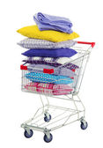 Shopping cart with pillows, isolated on white — Stock Photo