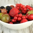 Ripe berries in bowl on table close-up — Stock Photo #29669517