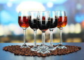 Glasses of liquors, on bright background — Stock Photo