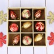 Wooden box filled with christmas decorations, on color wooden background — Foto de Stock