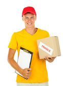 Young delivery man with parcel and clipboard, isolated on white — Stock Photo