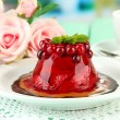 Tasty jelly dessert with fresh berries, on bright background — Stock Photo