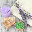 Still life with lavender candle, soap,   soap and fresh lavender, on wooden background — Stock Photo
