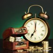 Antique clock and coins on wooden table on dark color background — ストック写真 #29681649