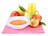 Tasty baby fruit puree and baby bottle isolated on white — Stock Photo