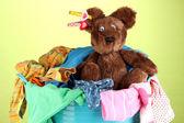 Blue laundry basket on green background — Stock Photo