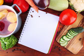 Fresh vegetables and spices and paper for notes, on wooden background — Stock Photo