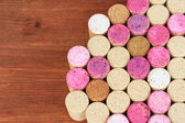 Wine corks on wooden table close-up — Stock Photo