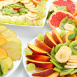 Assortment of sliced fruits on plates, close up — Stock Photo