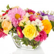 Beautiful bouquet of bright flowers in glass vase, isolated on white — Stock Photo