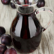 Stock Photo: Delicious plum juice on table close-up