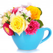 Beautiful bouquet of bright flowers in color mug, isolated on white — Stock Photo #29757417