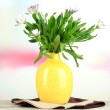 Bouquet of beautiful summer flowers in color vase, on wooden table , on bright background — Stock Photo #29757575