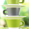 Three cups on nature background — Stock Photo