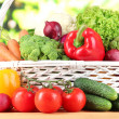 Fresh vegetables in white wicker basket on bright background — Stock Photo