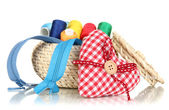 Wicker basket with accessories for needlework isolated on white — Stock Photo