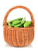 Sweet green peas in wicker basket isolated on white — Photo