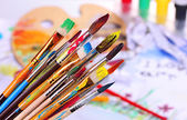 Many brush in paint on bright background — Stock Photo