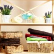 Stock Photo: Beautiful white shelves with different home related objects, on color wall background