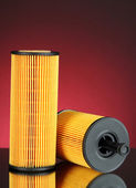Car oil filters on dark color background — Stock Photo
