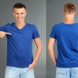 T-shirt on young man in front and behind on grey background — Stock Photo #29786097