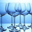 Photo: Empty wine glasses arranged on blue background