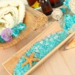 Sea spa elements on wooden table close up — Stock Photo