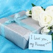 Romantic parcel on blue cloth background — Stockfoto