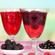 Jelly with fresh berries on pink wooden table — Stock Photo