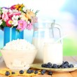 Stock Photo: Fresh dairy products with blueberry on wooden table on natural background
