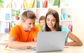 Group of young students sitting at the library — Stock Photo