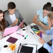 Business team working on their project together at office — Stock Photo #29860875