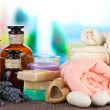Stock Photo: Still life with lavender candle, soap, massage balls, soap and fresh lavender, on bright background