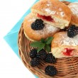 Stock Photo: Tasty donuts with berries, isolated on white