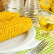 Flavored boiled corn on plate on wooden table close-up — Stock Photo #29861135