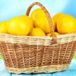 Ripe lemons in wicker basket on table on bright background — Stock Photo #29861169