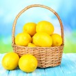 Ripe lemons in wicker basket on table on bright background — Stock Photo #29861171