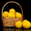 Ripe lemons in wicker basket isolated on black — Stock Photo #29861177