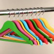 Colorful clothes hangers on gray background — Stock Photo #29861461