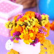 Stock Photo: Bouquet of marigold flowers in watering con wooden table close-up