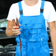 Stock Photo: Young driver with battery jumper cables to charge dead battery