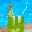 Tasty cocktail on swimming pool background — Stock Photo #29861687