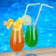 Tasty cocktails on swimming pool background — Stock Photo #29861691